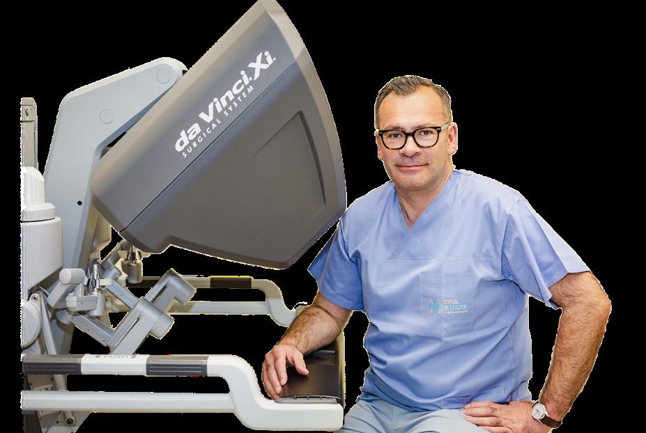 Dr n. med Paweł Szymanowski i robot da Vinci
